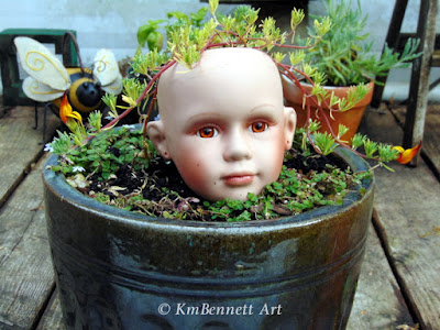 Blooming Hair broken doll head planter