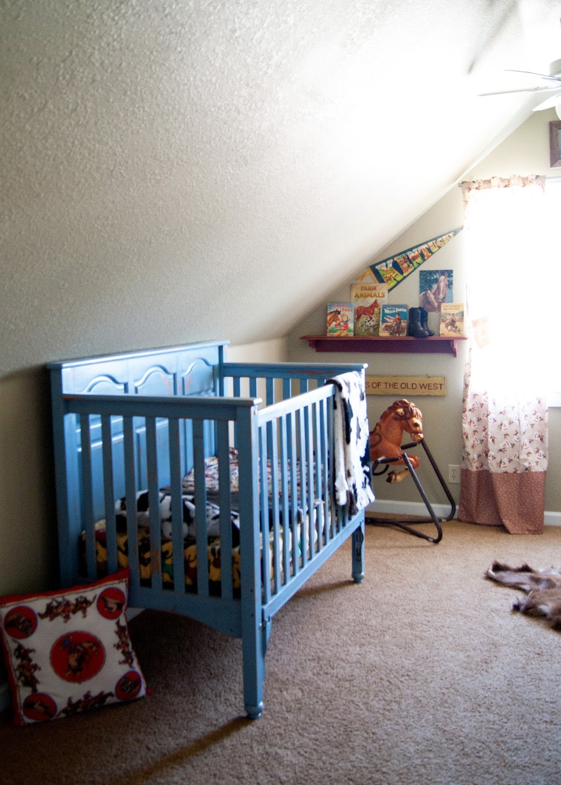 Chalk painted crib, hand sewn curtains and flea market finds make this vintage western room cozy and fun!