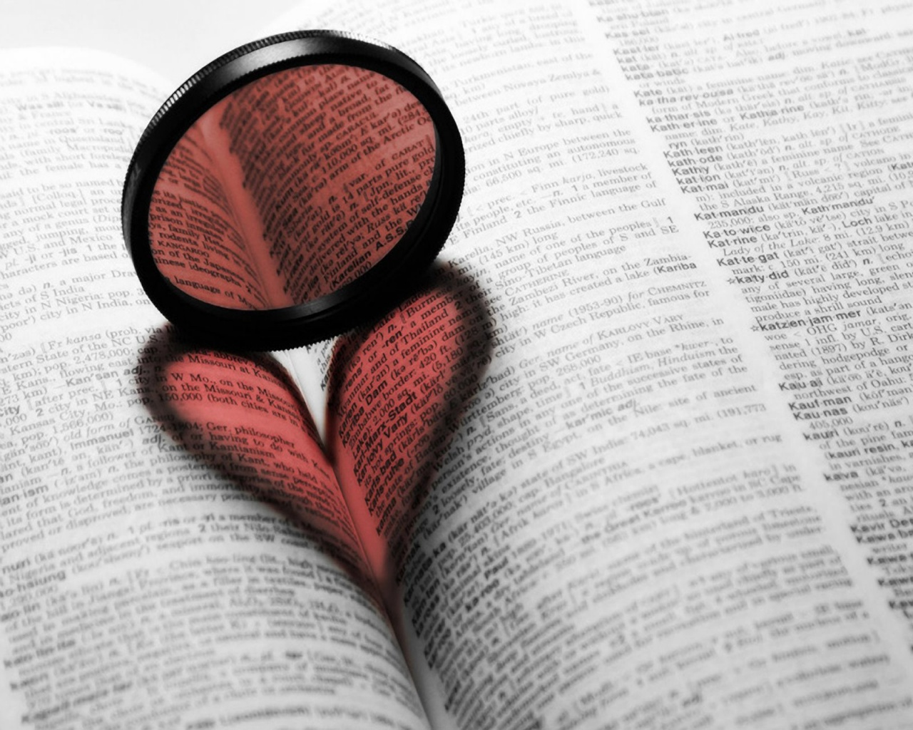 Book with a red shadow in a shape of heart