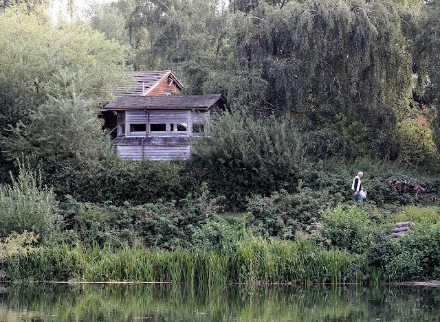 A birdwatching hide and the back of the visitor centre on Sevenoaks Wildlife Reserve, 21 August 2011.