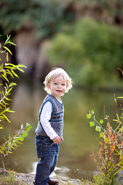 Family photo session yields adorable photograph of little boy by water