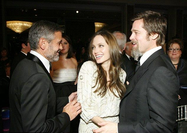 Brad and Angeline talked so happy with their best friend, George Clooney in December 2009 at the UNICEF snowflake Ball.