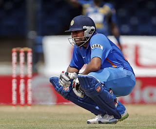 Rohit-Sharma-Grimaces-India-vs-Srilanka-Tri-Series-2013