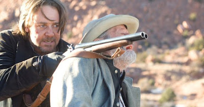 Russell Crowe playing the villain in 3:10 To Yuma (2007) holding a hostage at bay with a shotgun.