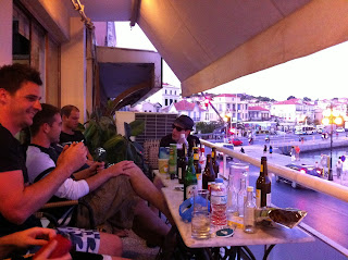 Drinking on the balcony of the Sappho Hotel.