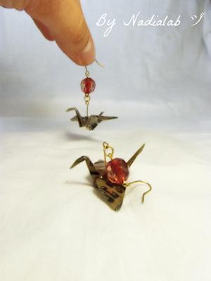orecchini gru con pietra rossa