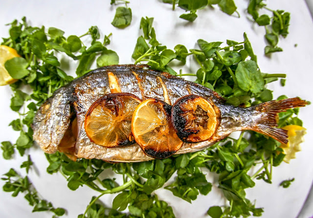 Baked sea bream with lemon and chilli