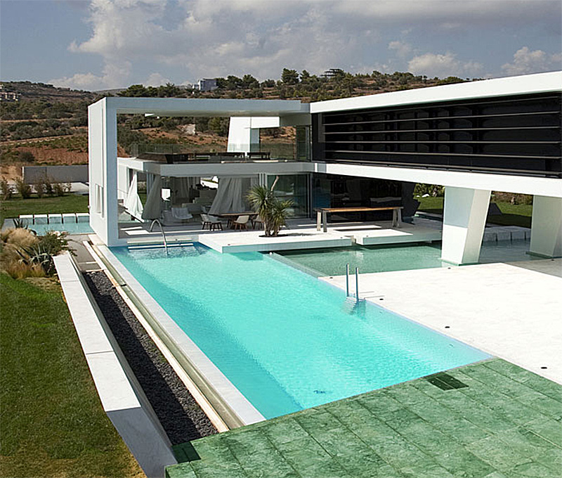 Huge modern athens home with a squash court gym and three swimming
