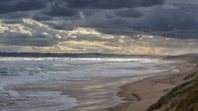dark clouds over woolamai surf beach