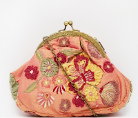 http://www.asos.com/moyna/moyna-clutch-with-vintage-style-clip-top-and-embroidered-floral-applique/prod/pgeproduct.aspx?iid=5572553&clr=Flame&SearchQuery=pink+top&pgesize=36&pge=0&totalstyles=633&gridsize=3&gridrow=8&gridcolumn=2