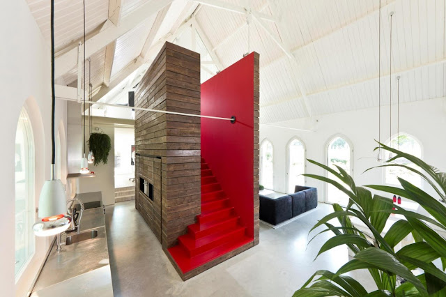 Picture of wooden structure with red staircase to the mezzanine floor