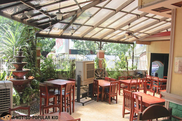 Outdoor dining area of Mama Lou's in Las Piñas