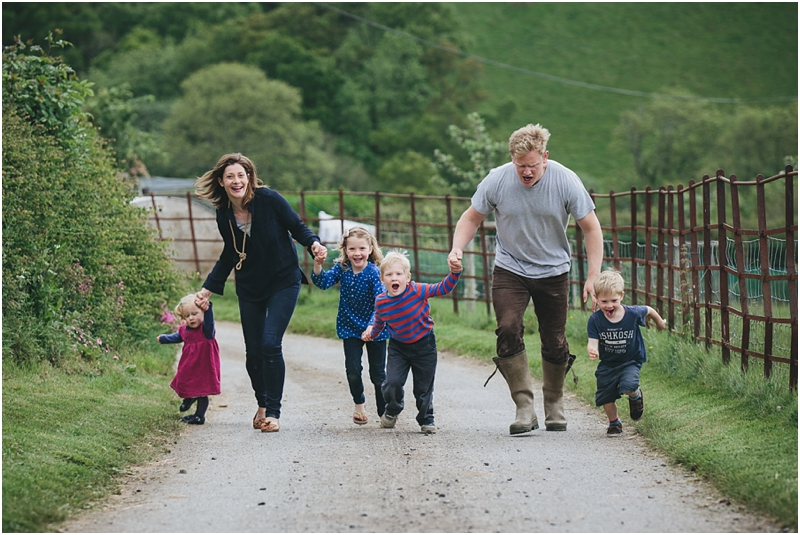 The Ursell family running up the lane at their farm in Devon