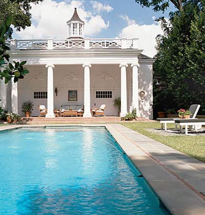 architects bill curtis and russel windham designed this gorgeous pool house to mimic the main house in all its gorgeous white southern glory