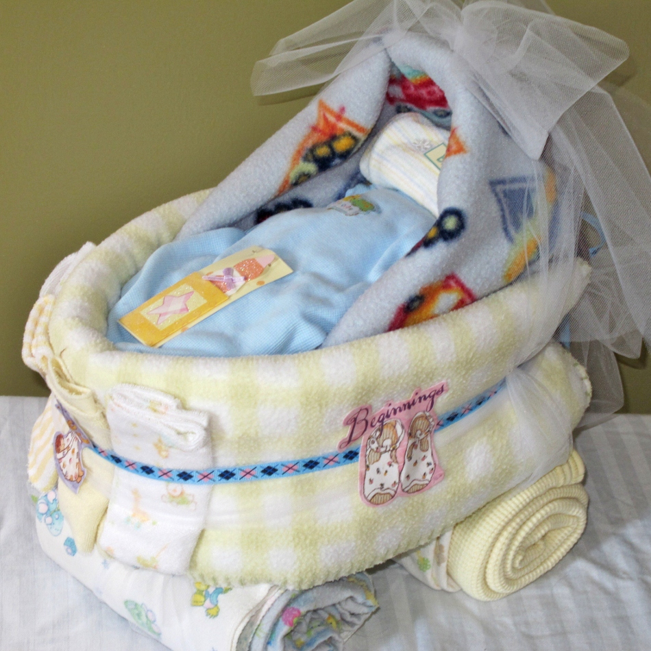 Adorable blue or pink baby carriage diaper cake
