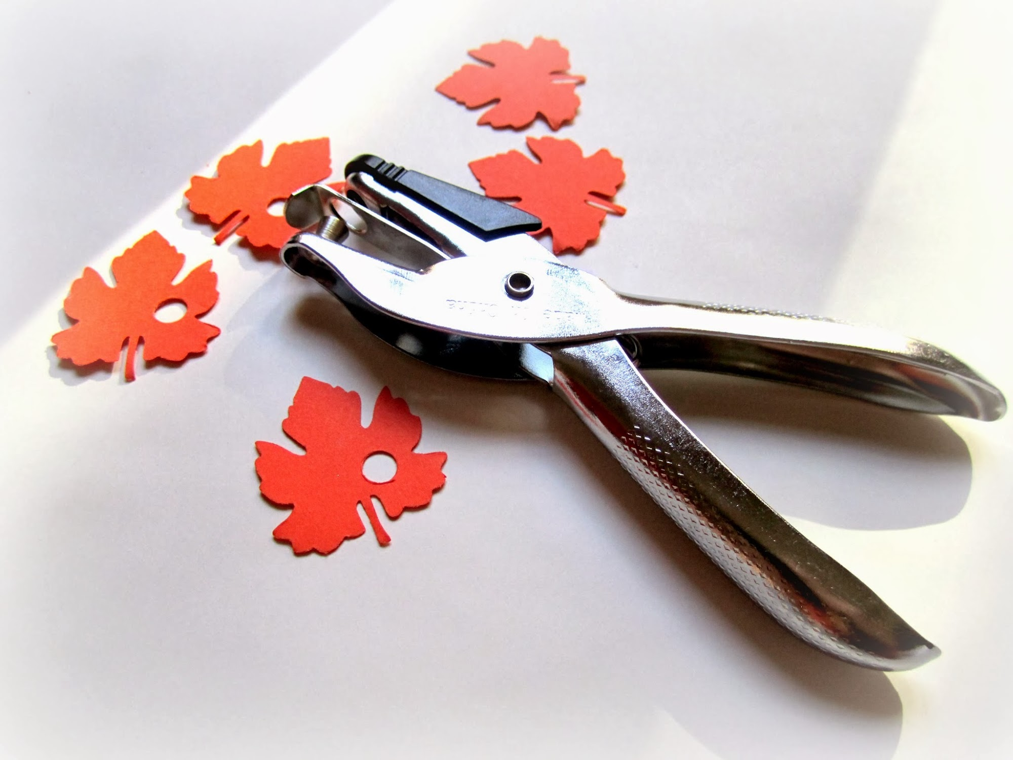 paper leaf hole punch