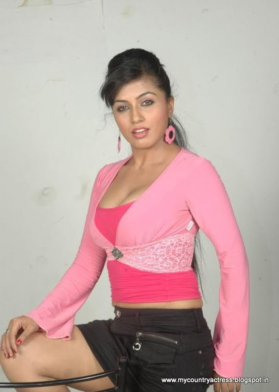 Aarthi puri posing in a pink tank top and baby pink overlay with a denim skirt. - Aarthi Puri hot photos