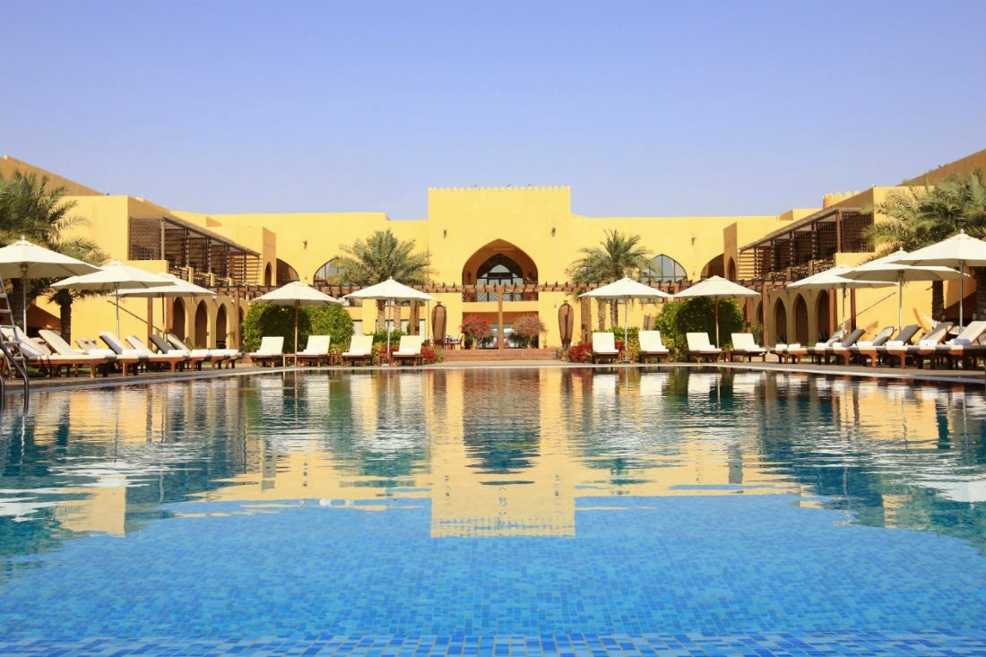 Tilal Liwa Hotel has a large outdoor pool that overlooks the sweeping desert