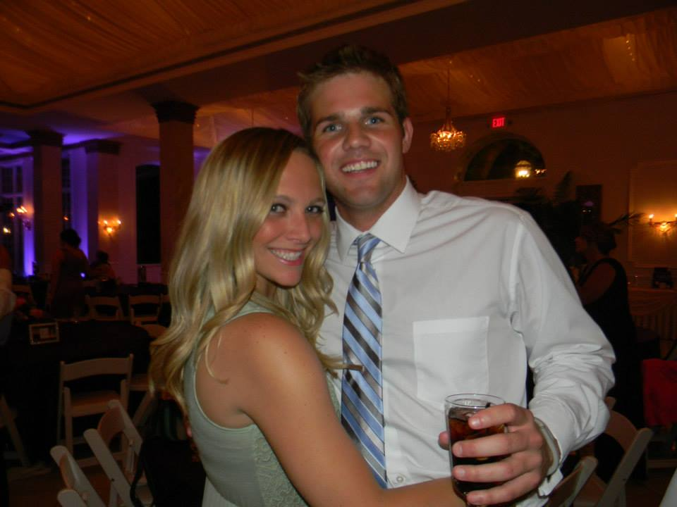Casey and Finn at a wedding reception having a good time.