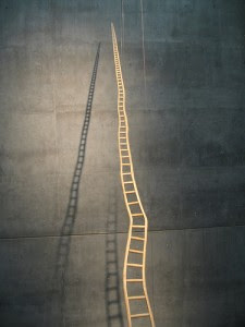 long crooked ladder that gets smaller as it goes higher
