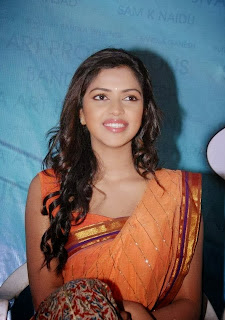 Amala Paul Looks Super Cute in Beautiful Orange Saree