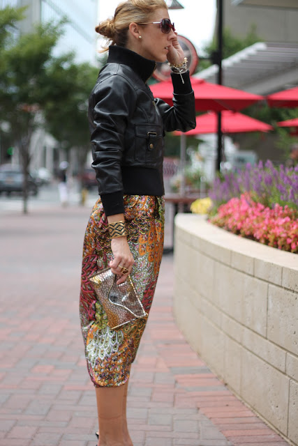 Forever 21 Motorcycle Jacket, Woman Shops World Harem Pants worn as jumpsuit, Kate Spade Heels, Blinde Sunglasses, JJ Winters Clutch, Melinda Maria Cocktail Ring, Stella & Dot Pegasus Necklace and Bracelets