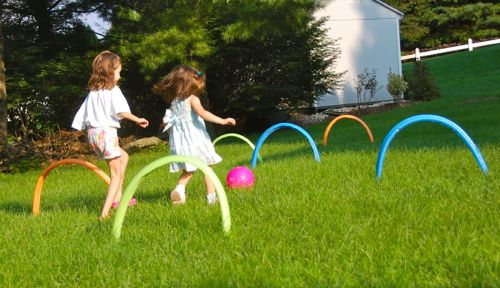 Kick Croquet with pool noodles for a fun game