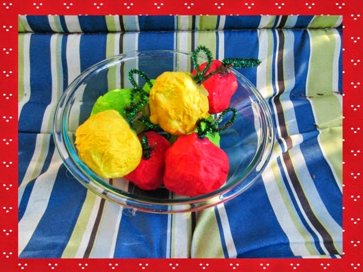 http://lovethosekinders-kinderkay.blogspot.com/2014/06/paper-mache-apples-and-bright-ideas.html