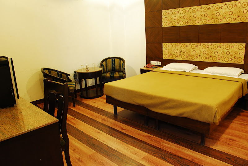 Suite Room is clean and has nice wooden flooring. It is one of the  title=