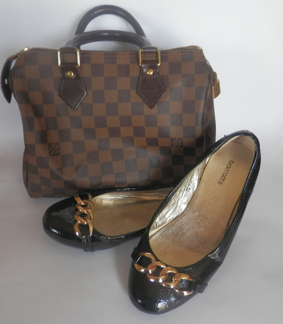 Louis Vuitton and black pumps