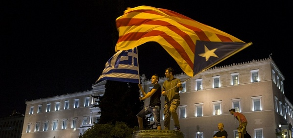 Athens 15-06-29: Greek & Catalonian 'Estelada' flags flying.
