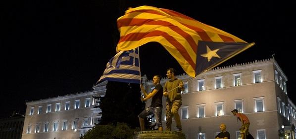 Athens 15-06-29: Greek & Catalonian 'Estelada' flags flying.