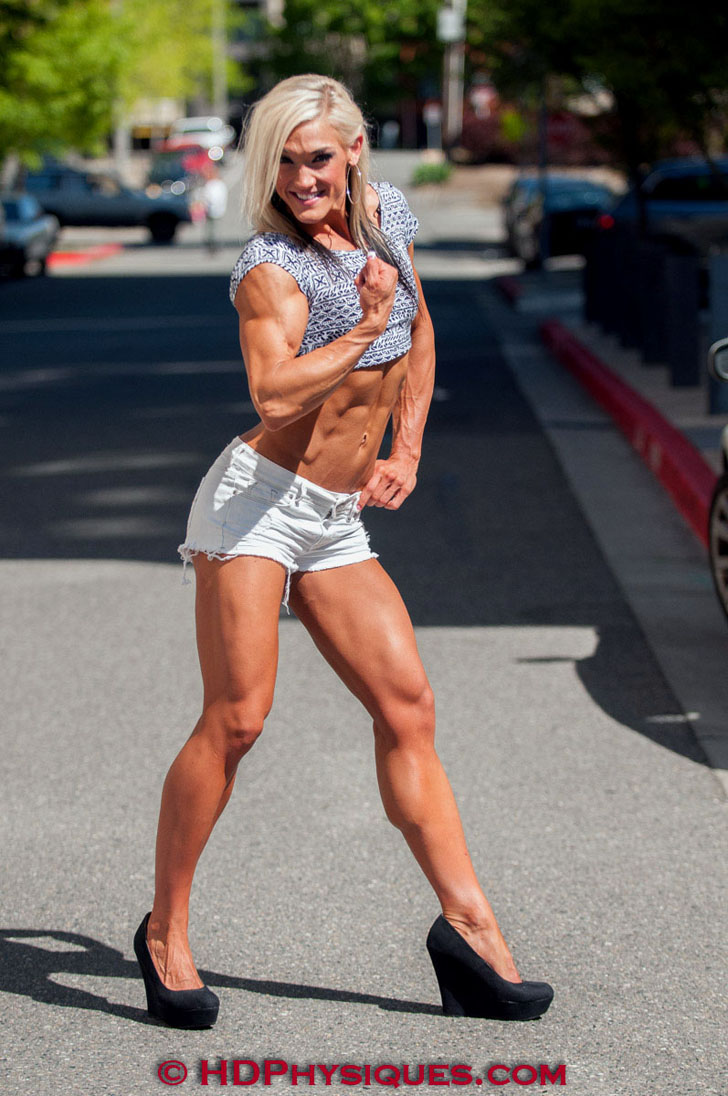 Rikki Smead Flexing Her Bicep And Posing Her Great Legs
