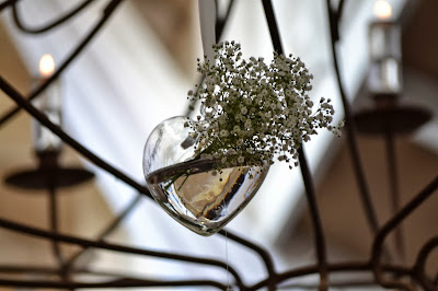 White flowers in heart shaped hanging container