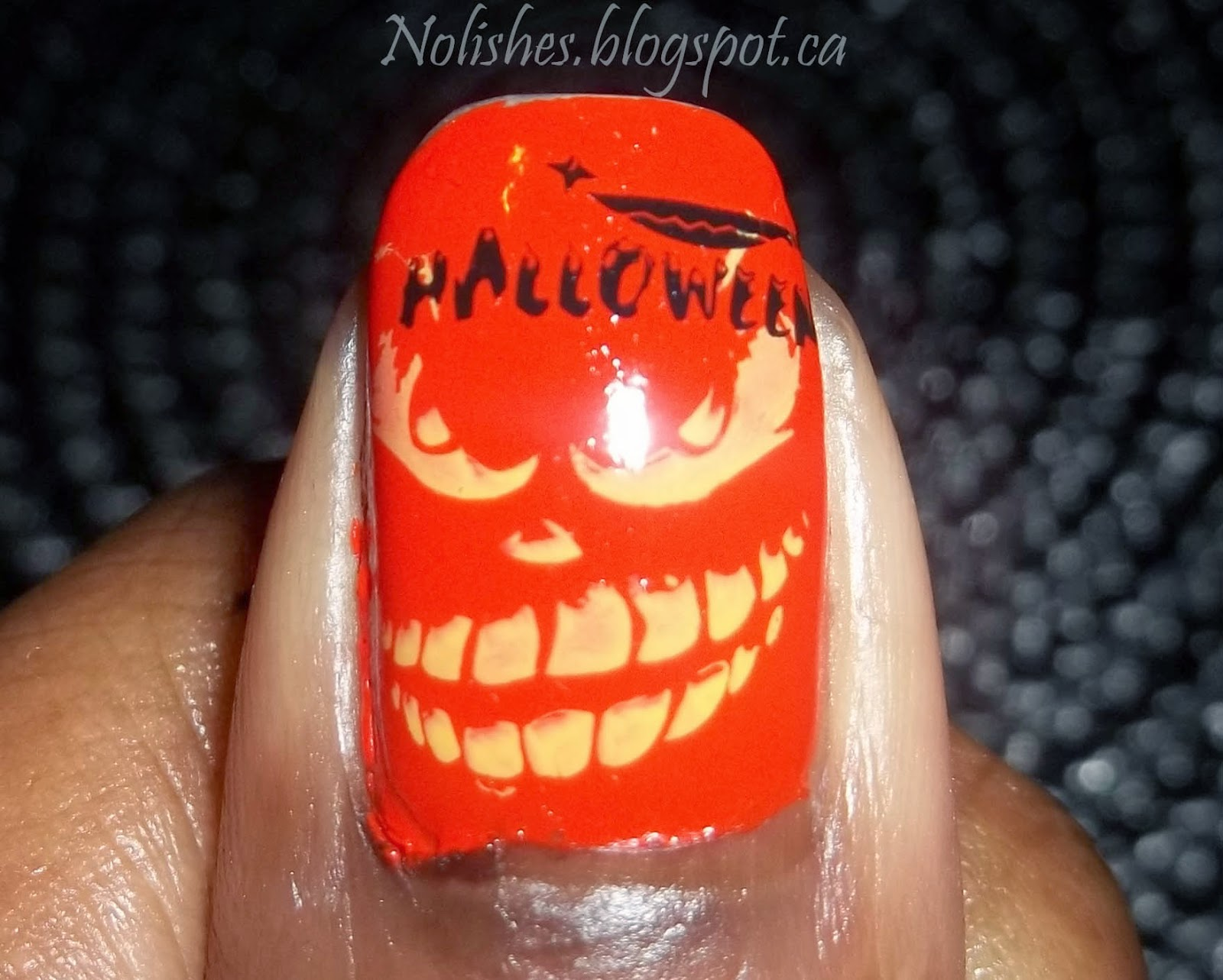 Halloween Themed Nail Stamping Manicure using Orange, Black, and Yellow Nail Polishes (Thumb Only)