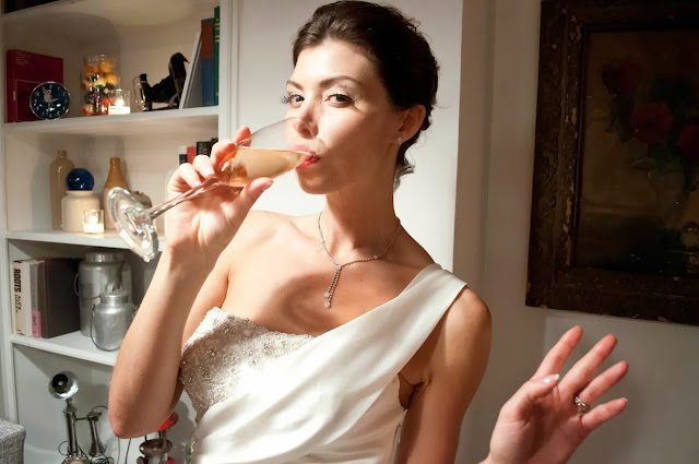 A Model Wedding, bride sips champagne at Gary's Lofts
