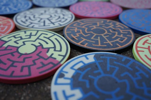 closeup of array of resin cast maze coaster