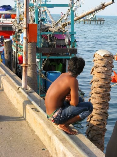 Shirtless boy on Pattaya pier