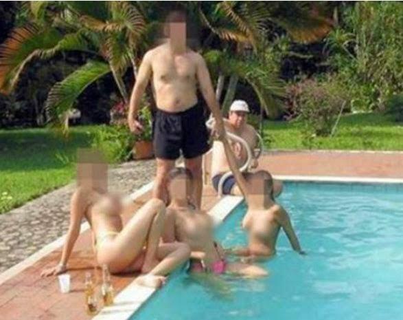 Diputado se puso medio contento y se tomo fotos con mujerones desnudas