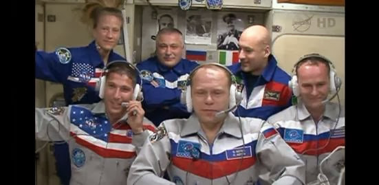 New Expedition 37 crew members Oleg Kotov, Mike Hopkins and Sergey Ryazanskiy were welcomed aboard the International Space Station Thurs. at 12:34 a.m. EDT. Credit: NASA TV