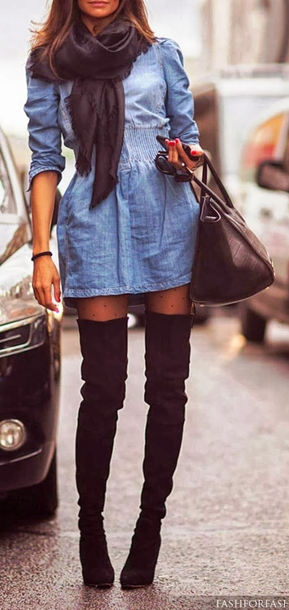 Long black knee boots and denim dress