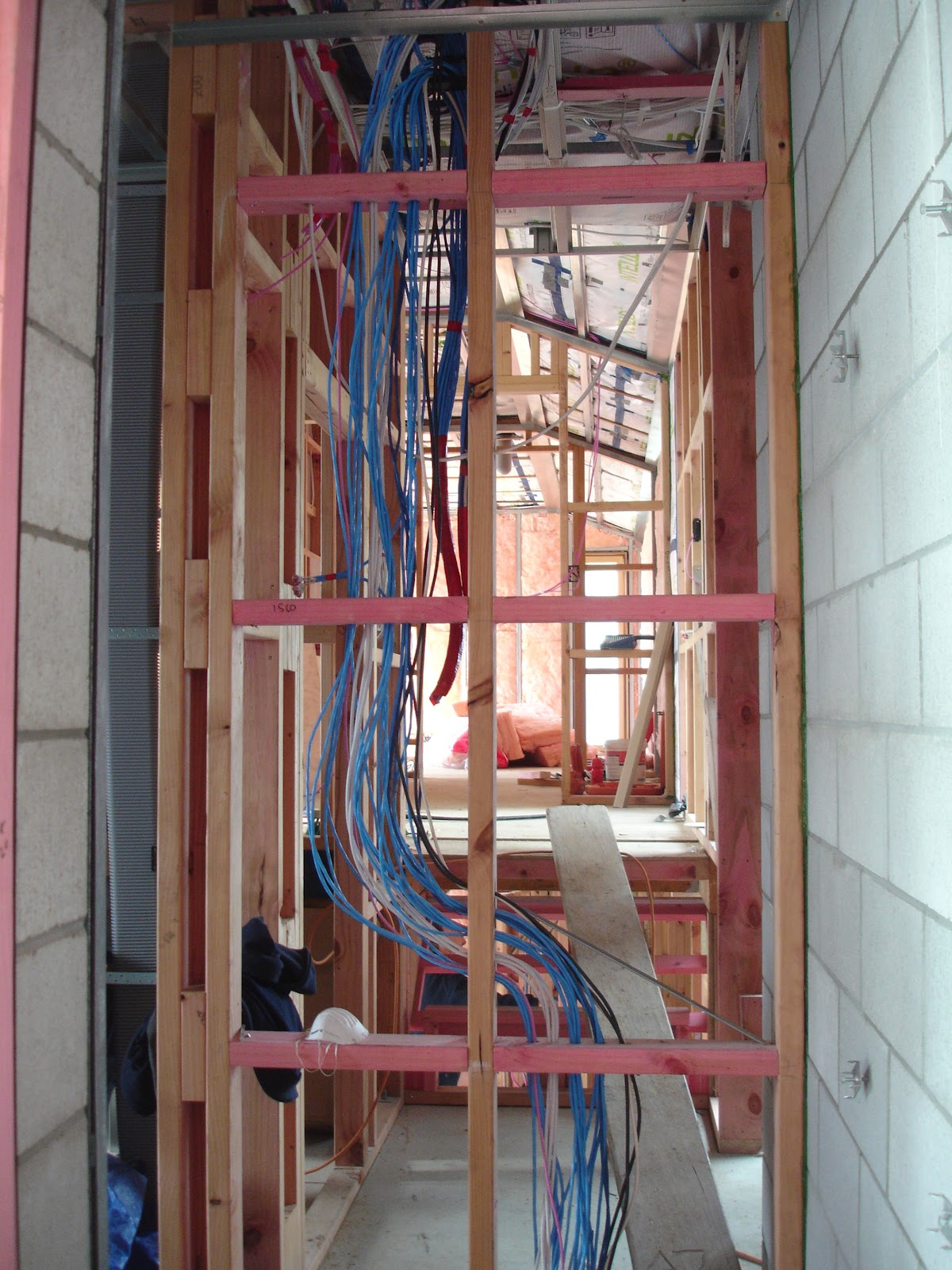 Wiring The New Zealands First Passive House Wires And Power Plug Protruding From A Wall During Rewiring By An For Is Being Threaded Through Walls Ceilings To Facilitate Needs Each Space Room Are Taped Surface They