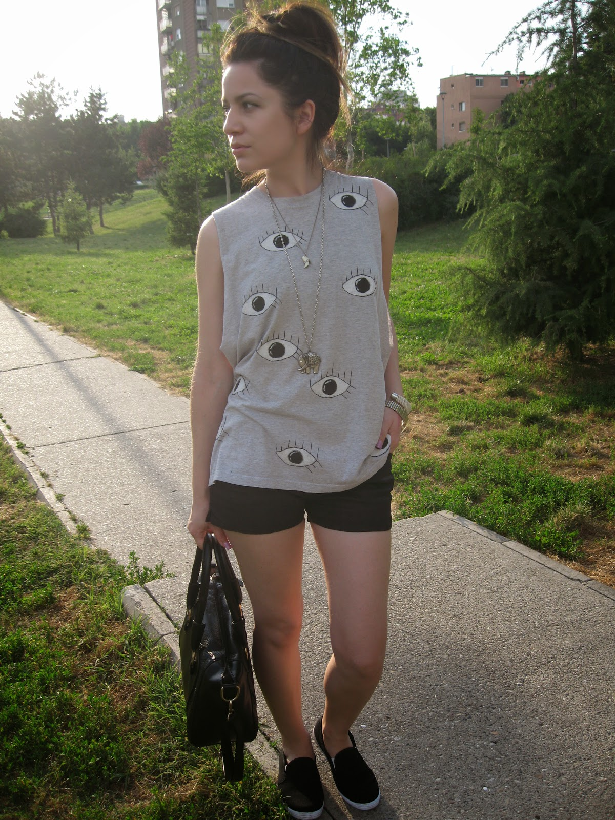 black slip ons, black tote bag, black shorts, DIY eye print tee, casual look, messy bun, lazy spring sunday outfit