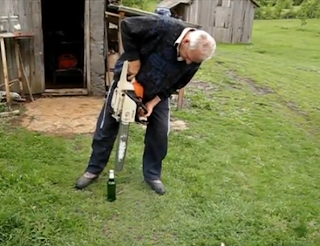 Funny picture: grandfather opens a beer with chainsaw