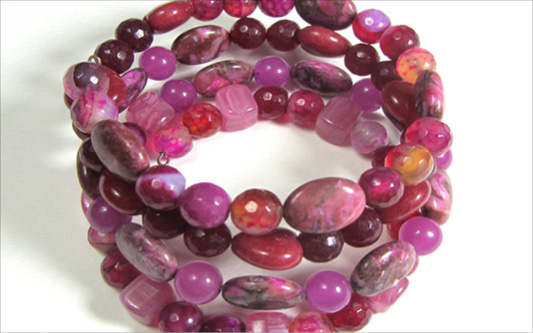 Beaded wrap bracelet with semi precious beads in pink and red