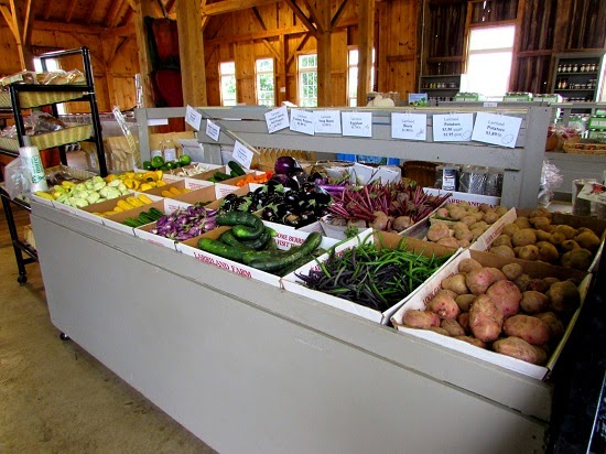 A stand full of fresh vegetables at the store- Larriland Farm