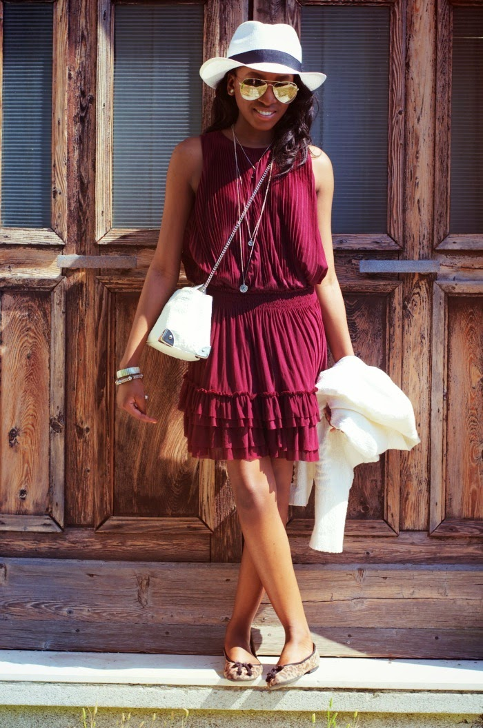 wearing a burgundy dress in venice, italy