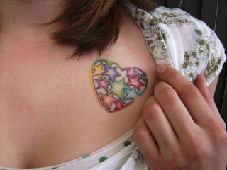 girls love breast tattoos