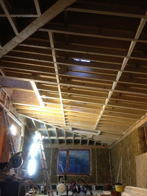 Electric mitre-saw and view of the roof, with two layers of rafters to allow insulation.