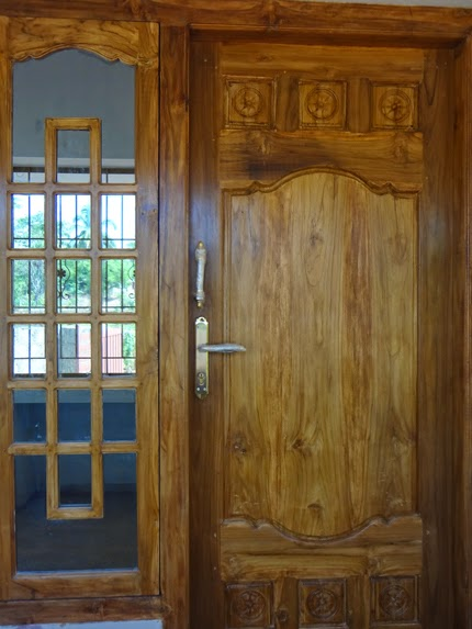 Kerala model front door design wood work kerala style for Door models for house